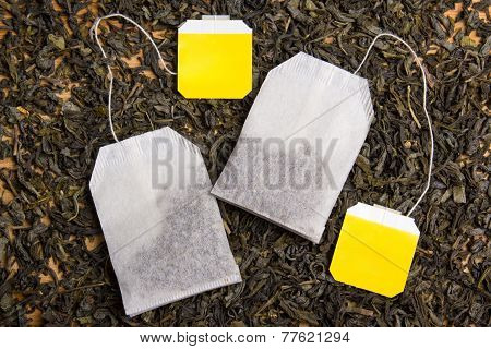 Background With Dried Black Tea And Tea Bags