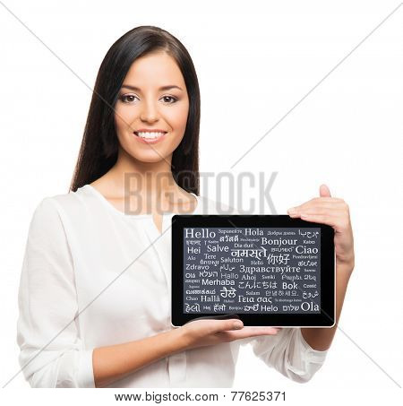 Teenager girl with a tablet computer. Different world languages concept.