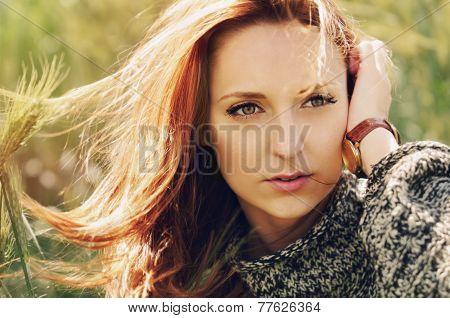 Portrait Of Attractive Business Woman With Watch Looking Into The Distance