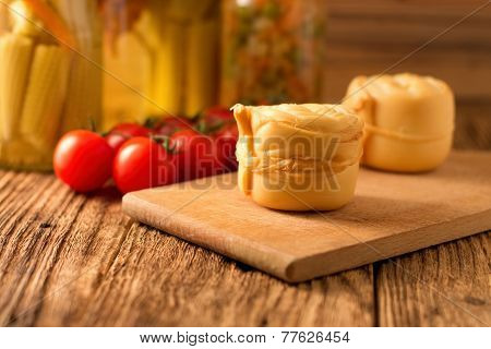 Steamed Rolled Cheese On Wooden Board