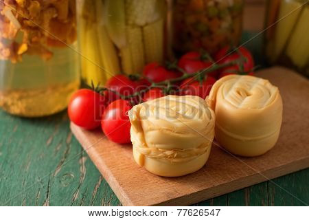 Two Steamed Rolled Cheeses On Green Table