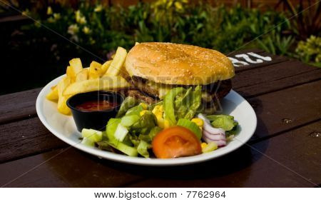 burger, chips and side salad