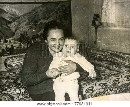 SZCZECINEK, POLAND, APRIL 12, 1962: Vintage photo of  grandmother with her baby grandchild