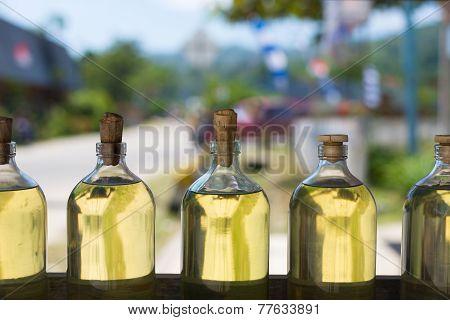 Bottles Of Golden Transparent Liquid
