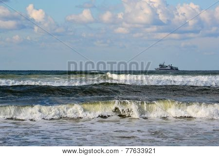 Catamaran On Waves Of The Black Sea In The Summer In A Sunny Weather.