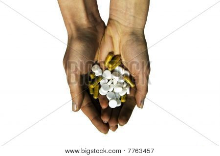 White and yellow medicinal means in hands of the girl