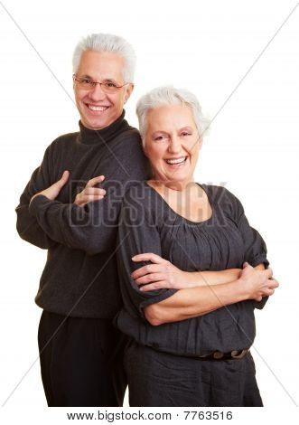 Elderly Couple Leaning On Each Other