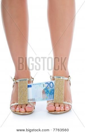 woman legs with money on white background