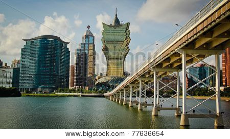 MACAU  CHINA - MAY 25:  View of hotel Lisboa and governor Nobre Carvalho also known as the Macau-Taipa Bridge, first bridge in Macau, to connect the peninsula and Taipa in Macau, China, may 25, 2014