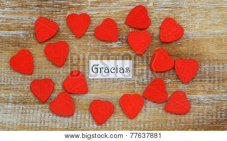 Gracias (which means thank you in Spanish) with little red wooden hearts