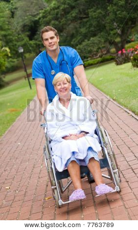 portrait of nurse pushing patient