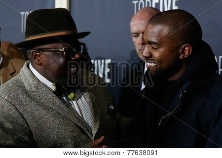 NEW YORK-DEC 3: Comedian/actor Cedric the Entertainer and rapper Kanye West attend the