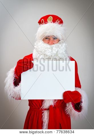 Shy Santa Claus Is Holding White Blank.