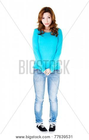 Full length shy woman standing.