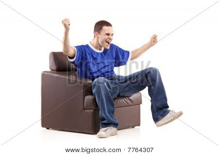 A sport fan sited in a chair