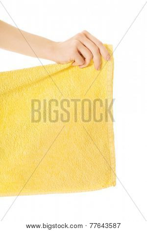 Close up on woman hand holding yellow towel.