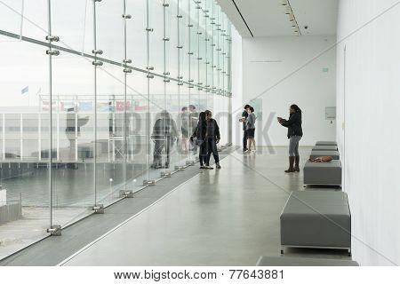 Taking selfies in modern building.