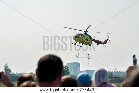 People waiting of landing Eurocopter