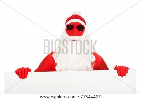 Portrait of santa in latex clothes holding empty banner.