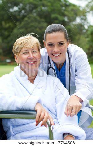 portrait of happy patient and nurse