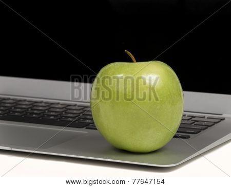 Closeup On Apple On Laptop