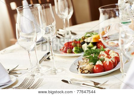 catering services background with snacks and glasses of wine on bartender counter in restaurant