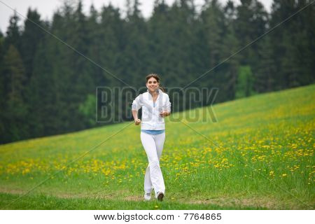 Jogging - Sportive Woman Running In Park With Dandelion