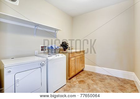 Laundry Room With White Appliances