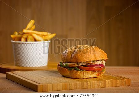 Tasty burger with melted cheese and thick succulent ground chicken patty, lettuce, tomato, onion, se