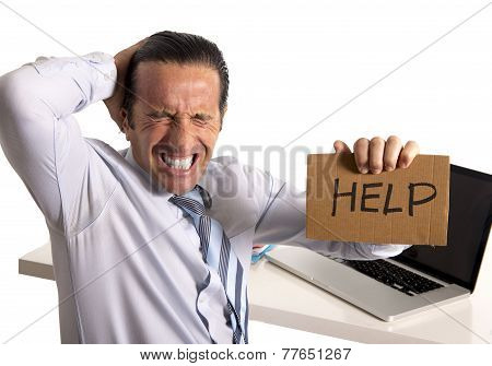 Desperate Senior Businessman In Crisis Working On Computer At Office In Stress