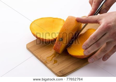 Trisecting A Mango Along Its Flat, Oblong Pip