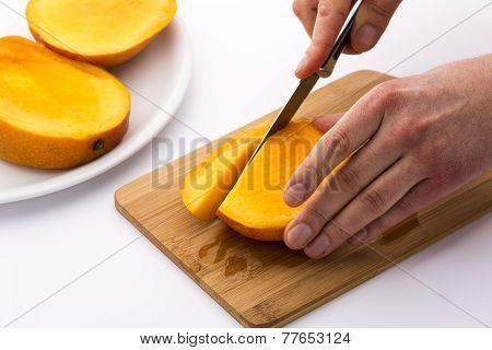 Subdividing The Mango Thirds Into Fruit Chips