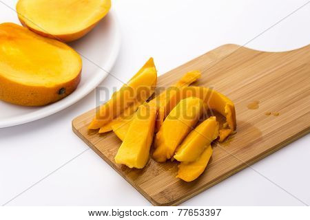 Mango Fruit Pulp And Its Peel On A Cutting Board