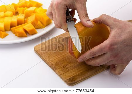 Peeling The Middle Mango Slice With The Fruit Pit