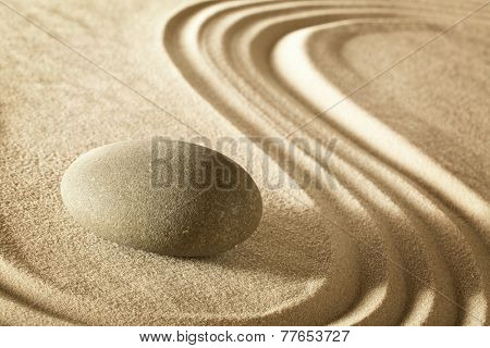 zen stone in japanese meditation garden. Rock and sand stands for balance harmony and spirituality. Spa wellness background