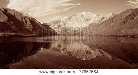 Snow mountain and lake BW with reflections panorama in Yosemite.
