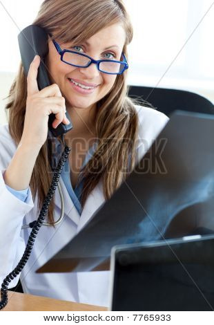 Happy Female Doctor Talking On The Phone