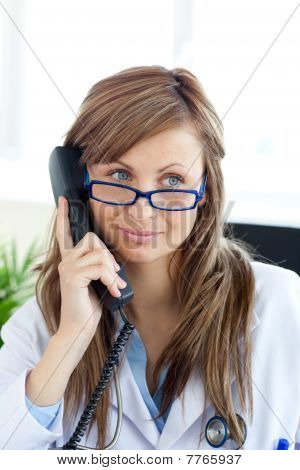 Radiant Female Doctor Talking On The Phone