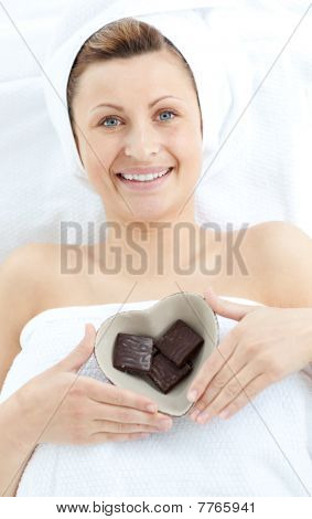 Cheerful Woman Holding A Bowl In The Shape Of A Heart With Chocolate