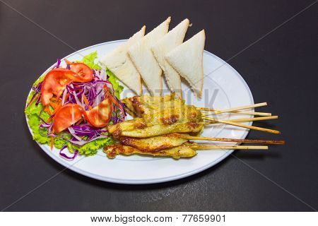 Grilled Pork Satay With Peanut Sauce And Vinegar On Table