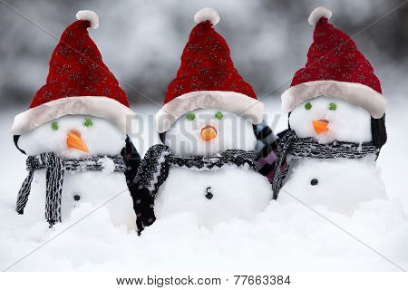 Snowmen With Christmas Hats