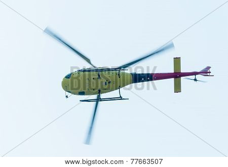 Pilot of Eurocopter AS-350 on airshow. Bottom view