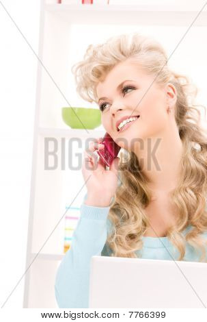 Lovely Woman With Cell Phone And Computer