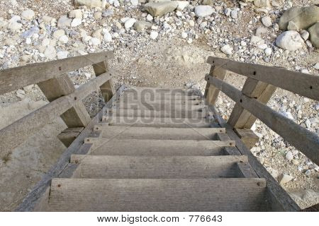 Outdoor wooden staircase with steps leading down