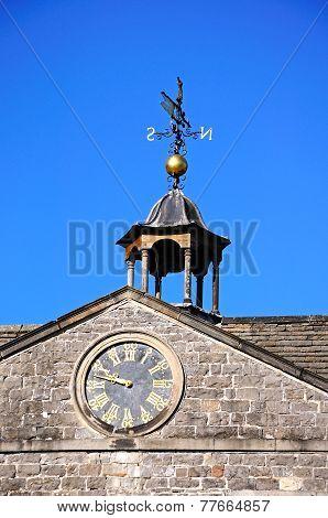 Clock and weathervane on Tissington Hall.