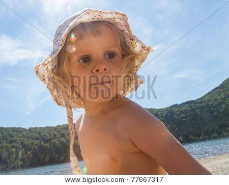 Little Toddler Girl In The Summer Sun