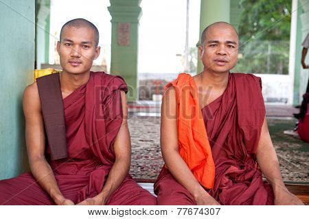 YANGON, MYANMAR - JANUARY 29 :Buddhist monks rest by a shrine in the Shwedagon  temple Jan 29, 2010, Myanmar.Shwedagon Pagoda temple being the most important Buddhist site for the people of Myanmar.