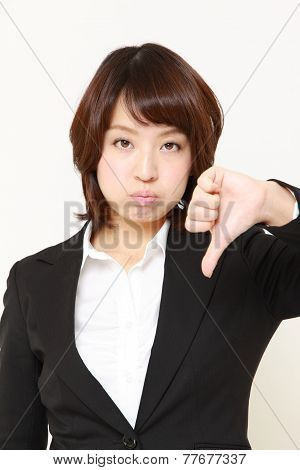 businesswoman with thumbs down gesture