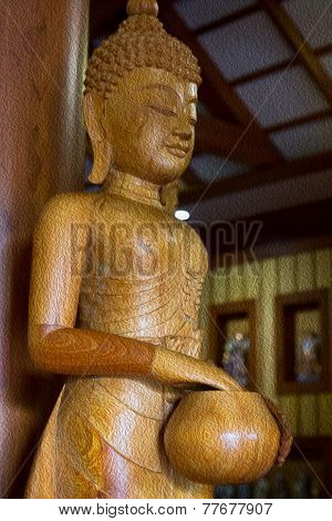 Wooden Buddha Holding Alms-bowl Statue