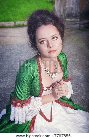 Beautiful Medieval Woman In Green Dress Praying